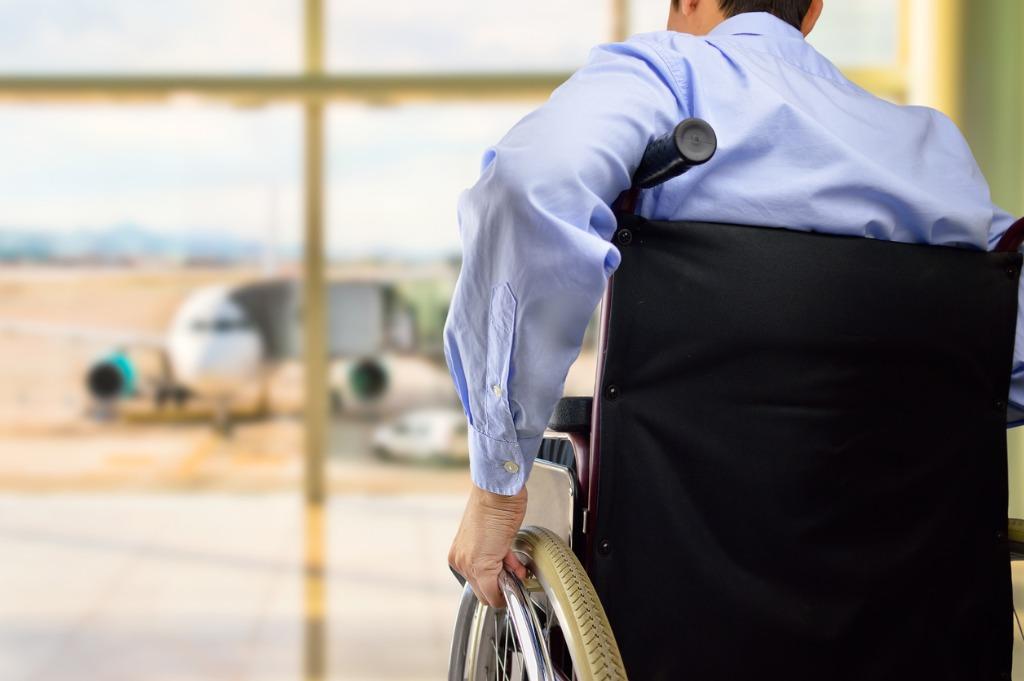 passenger sat in wheelchair at airport