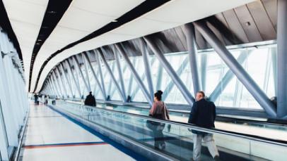 Airport passengers on bridge