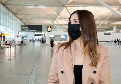 Passenger wearing mask at airport