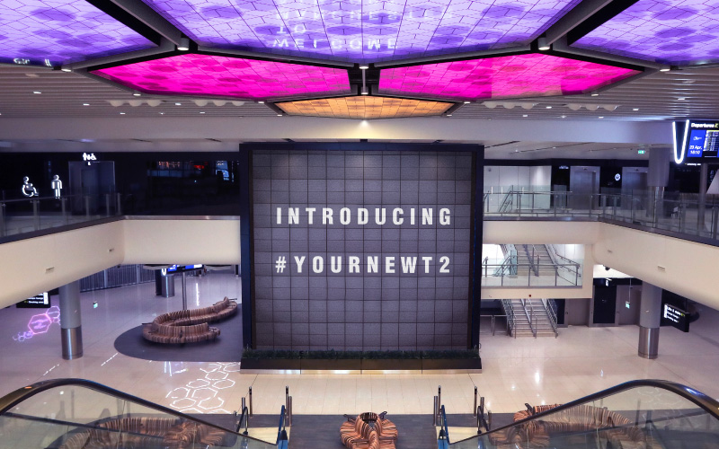 T2 departures hall with screen saying 'introducing #yournewt2'